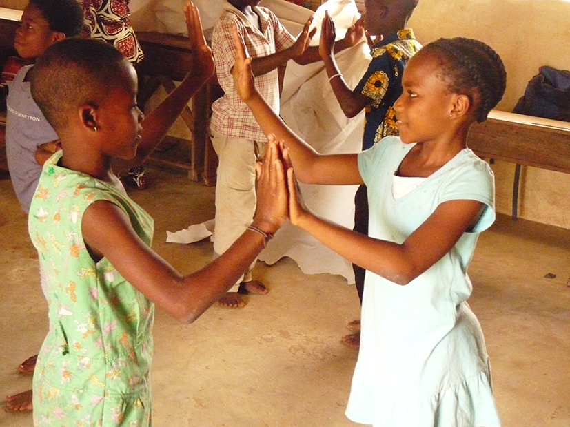 girls_playing_clapping_game